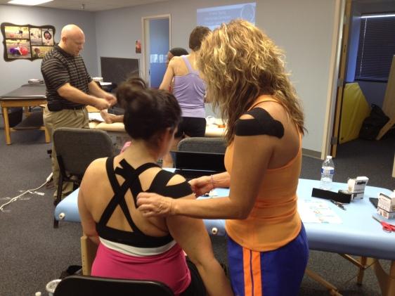 Students in Lenexa, Kansas, practice taping with CKTI Tom Lechtenberg.